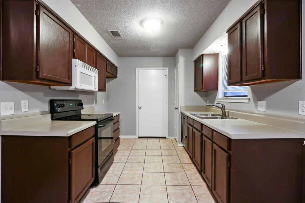 2453 Hallmark  Street, Grand Prairie, Texas 75052 - acquisto real estate best flower mound realtor jody daley lake highalands agent of the year