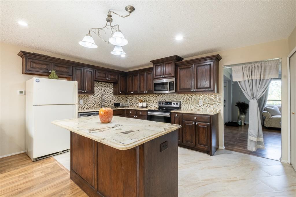 2718 Ivanridge  Lane, Garland, Texas 75044 - acquisto real estate best prosper realtor susan cancemi windfarms realtor