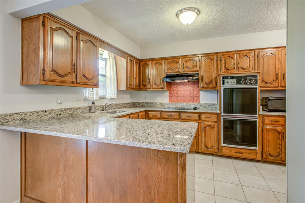 409 Brookfield  Drive, Garland, Texas 75040 - acquisto real estate best prosper realtor susan cancemi windfarms realtor