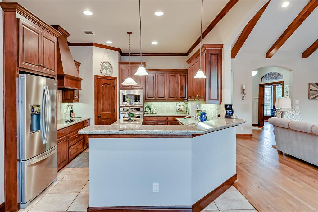 1040 Falcon Creek  Drive, Kennedale, Texas 76060 - acquisto real estate best new home sales realtor linda miller executor real estate